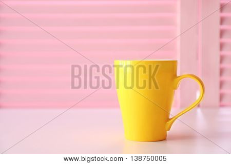 Cup on pink folding screen background