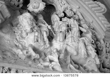 statue of men and horse in white marble poster