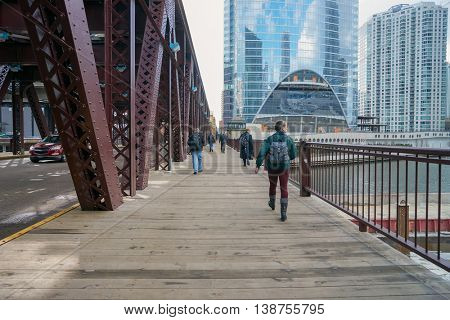 CHICAGO, IL - CIRCA MARCH, 2016: people across bridge in Chicago. Chicago is the third most populous city in the United States.