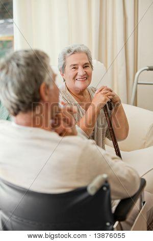 Senior couple talking in a hospital room