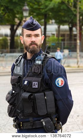 Paris France-July 14 2016 : The French policeman on duty in Bastille Day military parade on Champs Elysees avenue in Paris France.