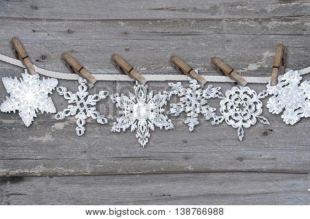 six white snowflake on grey wood background