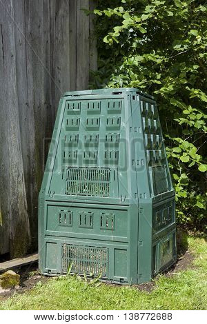 Image of compost bin in a summer garden
