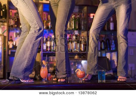 3 Women Dancing On Bar poster