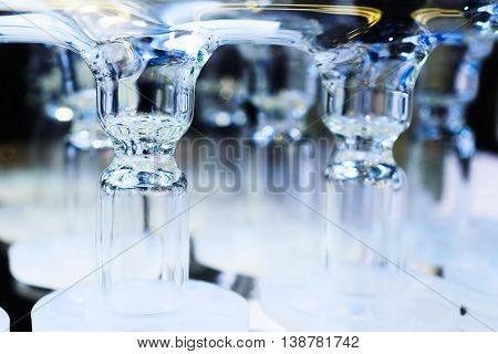 Abstract background with glass tubes. Detail of a Soxhlet extractor. Chemical laboratory equipment.