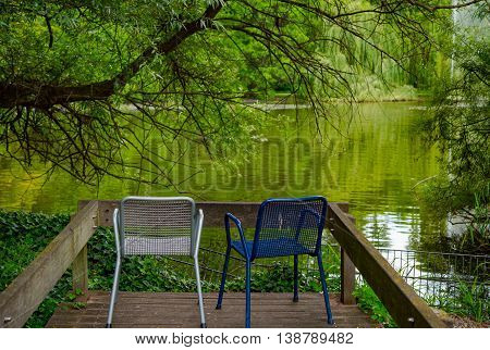 Chairs at shore of Lake in Germany
