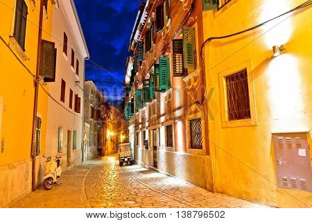 Old stone street of Rovinj evening view Istria Croatia