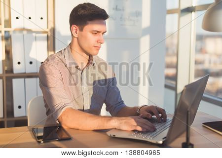 Man typing text or blog in office, hir workplace, using pc keyboard. Busyman working