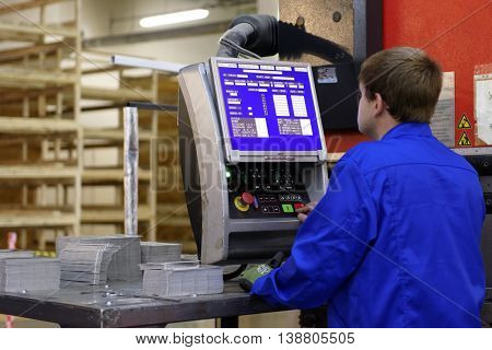ST. PETERSBURG, RUSSIA - JUNE 29, 2016: Worker of Innovative Production Association U-Piter at his workplace. The enterprise is one of the largest Russian producer of vehicle interior, parts, etc.