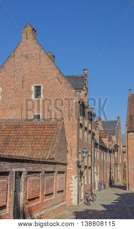 Street in the old quarter Begijnhof in Leuven Belgium