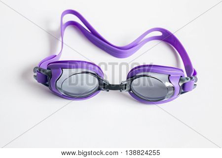 Purple swim goggles isolated on white background stock photo