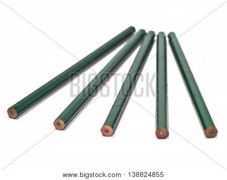 five unsharpened green pencils isolated on white background