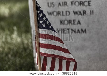 United States Flag on a soldier's gravesite at Arlington National Cemetery on Memorial Day