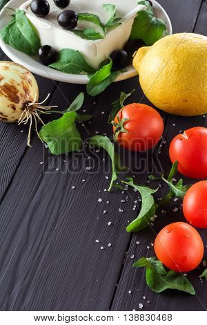 Vegetables for cooking Greek salad. On the blackboard