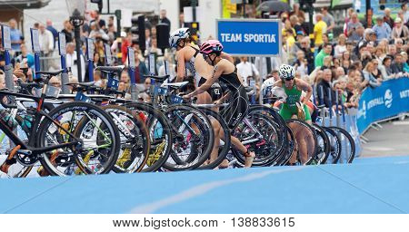 STOCKHOLM - JUL 02 2016: Switching from cycle to running in the transition zone in the Women's ITU World Triathlon series event July 02 2016 in Stockholm Sweden