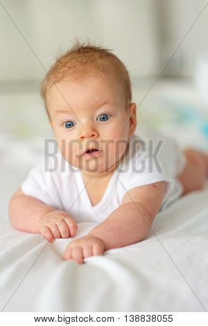 Three months old baby in bed