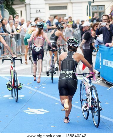 STOCKHOLM - JUL 02 2016: Triathlete Aoi Kuramoto running with cycle in the transition zone in the Women's ITU World Triathlon series event July 02 2016 in Stockholm Sweden