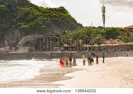 Cat Ba, Vietnam - May 12, 2014 - Vietnamese pop singer films music video at public beach at Cat Ba island