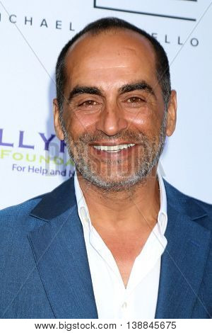 LOS ANGELES - JUL 16:  Navid Negahban at the HollyRod Presents 18th Annual DesignCare at the Sugar Ray Leonard's Estate on July 16, 2016 in Pacific Palisades, CA