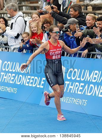 STOCKHOLM - JUL 02 2016: Winning triathlete Flora Duffy (BER) running at the finish in the Women's ITU World Triathlon series event July 02 2016 in Stockholm Sweden