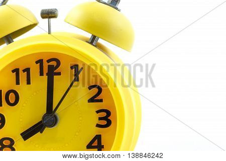 close up yellow alar clock isolation on white background
