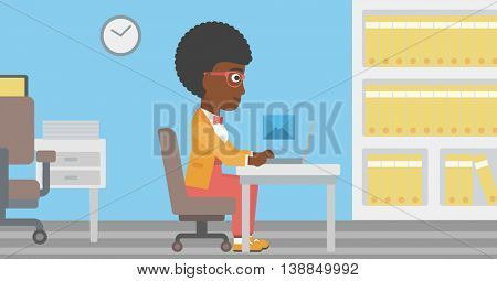 An african-american young business woman working on her laptop in office and receiving or sending email. Business technology, email concept. Vector flat design illustration. Horizontal layout.