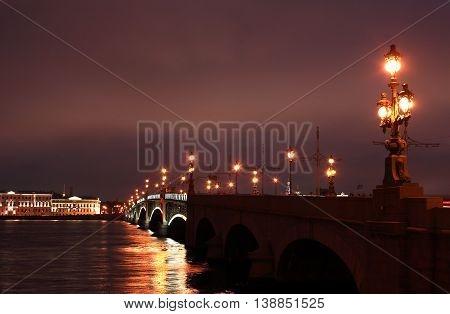 View of drawbridge across Neva river in Saint Petersburg at night Russia