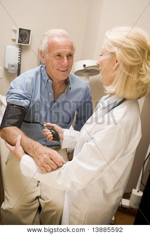 Doctor Checking Blood Pressure Of Man
