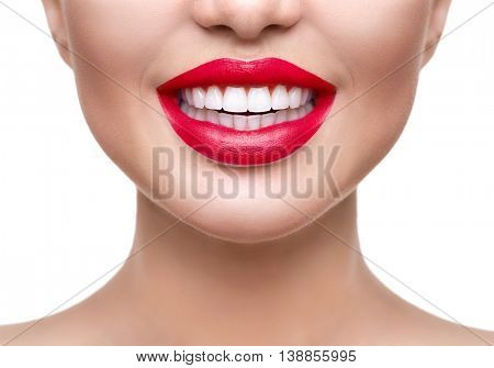 Teeth whitening. Healthy white smile close up. Beauty woman with perfect smile- lips and teeth. Beautiful Model Girl with red lips isolated on white background. Perfect skin
