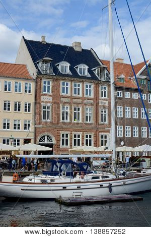COPENHAGEN, DENMARK - JULY 11, 2016: Nyhavn a 17th century harbour in Copenhagen with typical colorful houses and water canals, Nyhavn, Copenhagen, Denmark