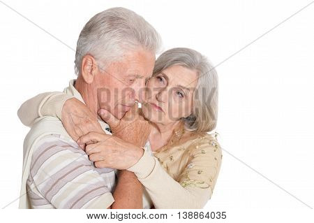 Portrait of sad senior couple at white background
