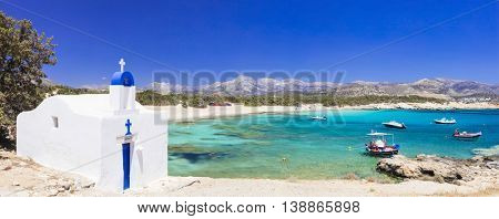 Traditional Greece - small church on the turquoise beach. Naxos