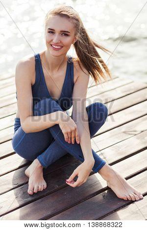 Portrait of woman in fitness wear near the sea