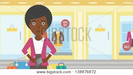 An african-american woman showing her epmty wallet on the background of showcase of a store. Vector flat design illustration. Horizontal layout.