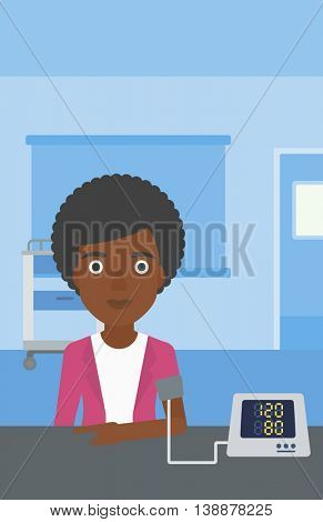 An african-american woman taking care of her health and checking her blood pressure with digital meter. Vector flat design illustration. Vertical layout.