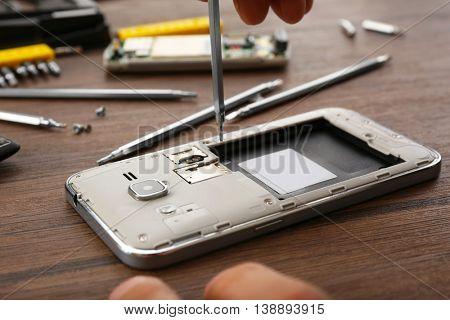 Mobile phone repair, closeup