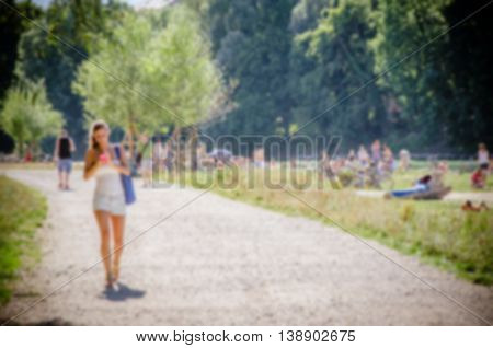 Abstract Blurred Activity Of A Girl Near The Isar River, Munich City, Germany