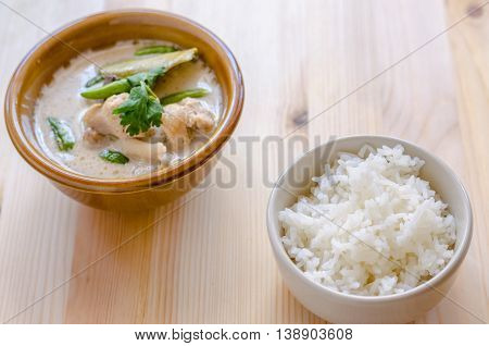 Thai Chicken Soup In Coconut Milk (tom Kha Gai) With Rice On Wooden Background, Thai Food.