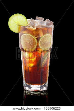 Cuba libre cocktail with rum and cola over black background
