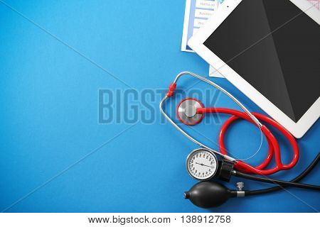 Medical concept. Medical stethoscope and  manometer on a blue background