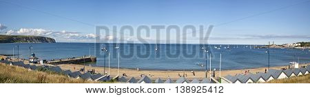 Swanage Dorset UK - July 2016. A panorama view of Swanage bay looking towards Bournemouth and Old Harry rock at Swanage in Dorset UK