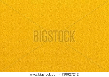 Yellow background from a textile material. Fabric with natural texture. Cloth backdrop.