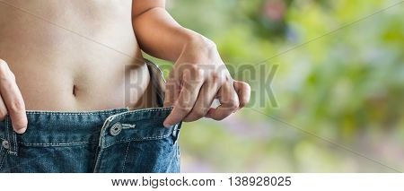 Hands And Big Loose Denim Jeans For Concept Lose Weight