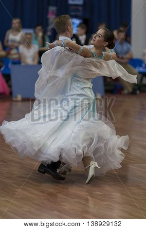 Minsk Belarus -May 28 2016: Levkovich Aleksander and Bugakova Evelina Perform Youth-2 Standard Program on National Championship of the Republic of Belarus in May 28 2016 in Minsk Belarus