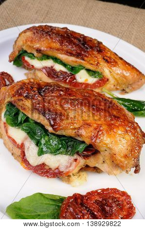 Stuffed breast baked with dried tomatoes mozzarella spinach
