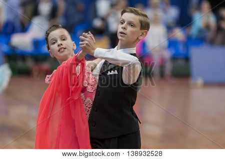 Minsk Belarus -May 28 2016: Gubeyko Aleksand and Yasevich Angelina Perform Juvenile-1 Standard European Program on National Championship of the Republic of Belarus in May 28 2016 in Minsk Republic of Belarus