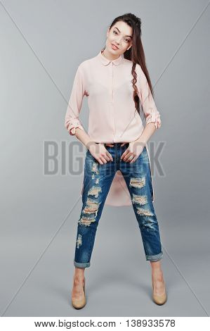 Full-length Portrait Young Smiling Brunette Girl Wearing In Pink Blouse, Ripped Jeans And Cream Shoe