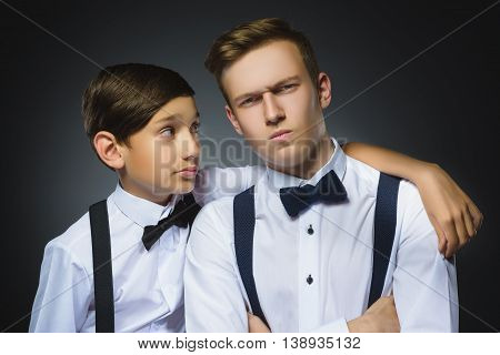 boy looks questioningly at disaffected teenager or brother.