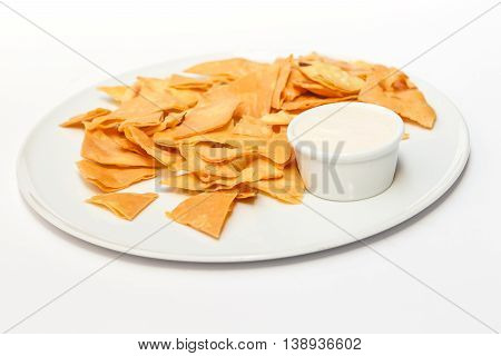 Homemade pita chips made from pita bread with olive oil on white background