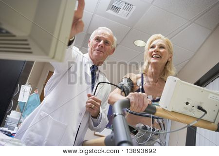 Doctor With Patient During Health Check